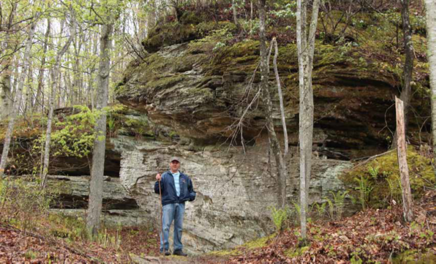 Craig Deatley has been a relentless advocate and volunteer for this project. He is shown by a fern-covered boulder at the proposed acquisition site.