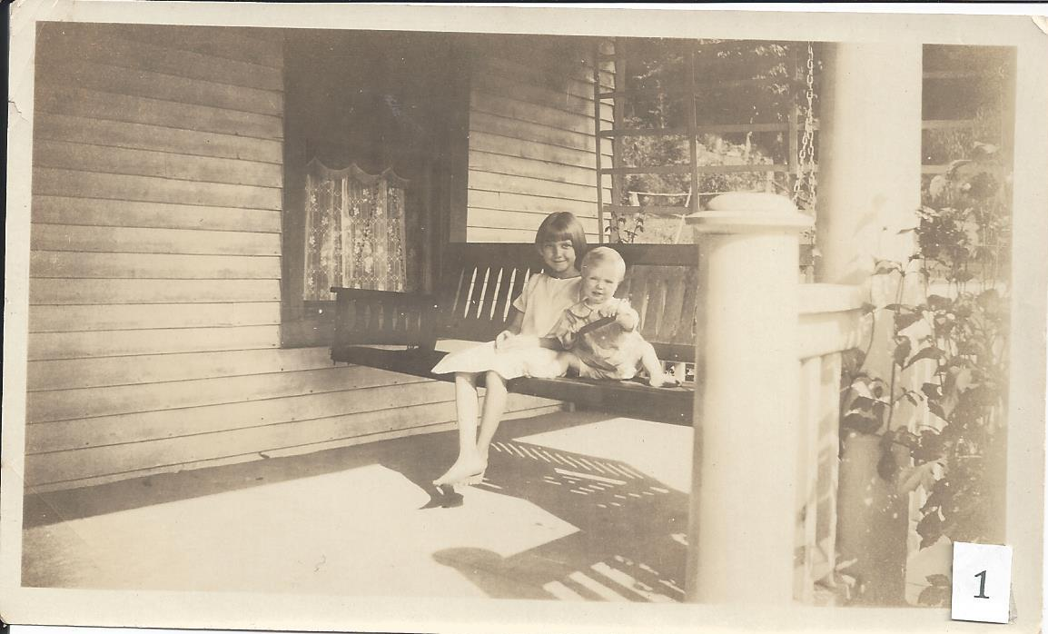Descendants Eva and Ralph Ivers on the porch of the family house, circa 1925.